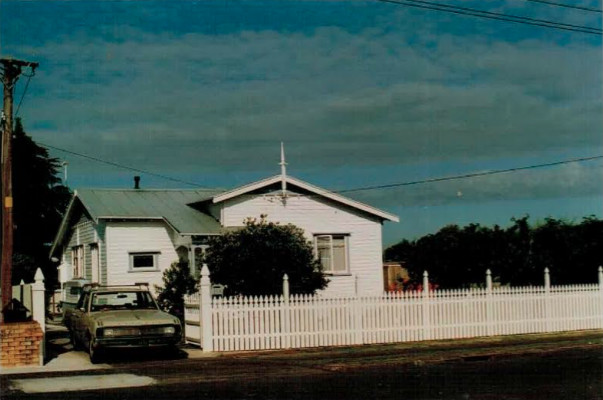 My house growing up in Manurewa. This photo is back when my father had just finished making and painting the f nce and gate. The car was our family valiant that took us on many road trips together.