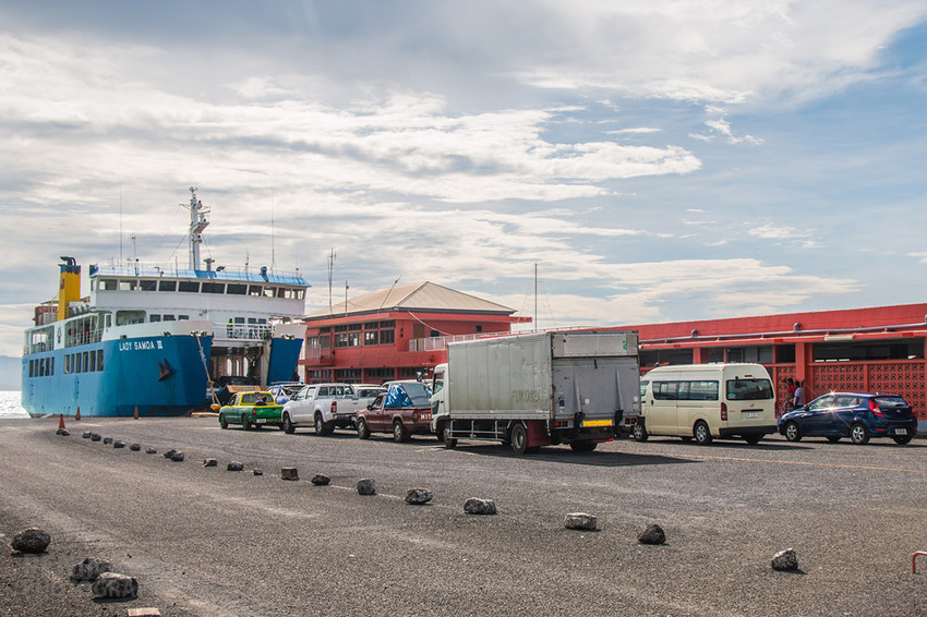 Cars lining up at Mulifanua wharf to drive on to the ferry - be sure to book in advance!