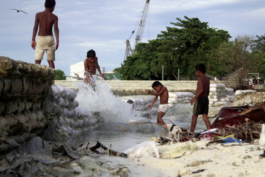 King Tide waves hitting through a seawall in Kiribati