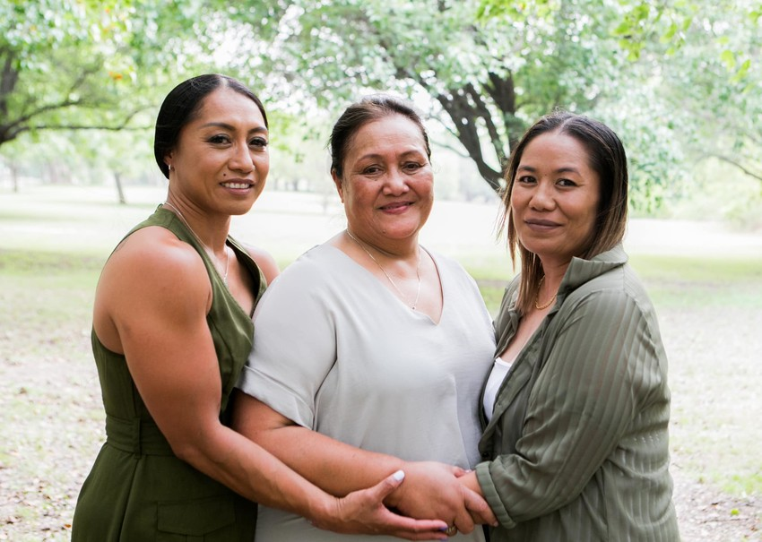 Priscilla, her mother and younger twin Patricia