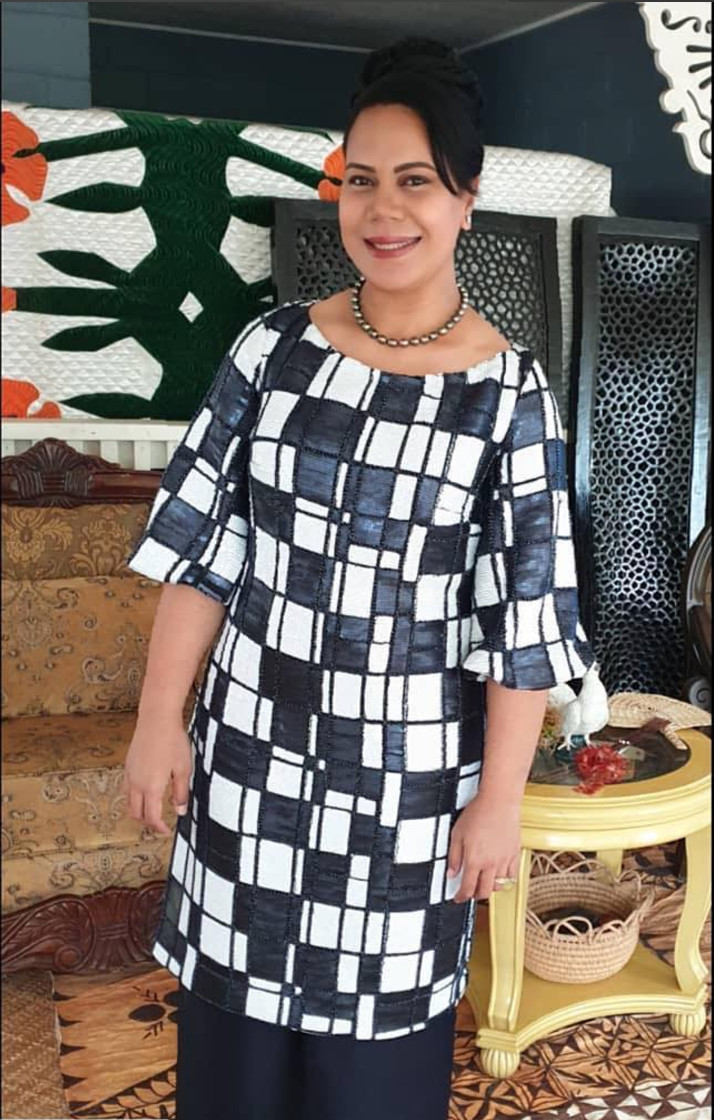 Honourable Frederica T Filipe wearing a dress designed by Beau which she wore to meet the Duke & Duchess of Sussex